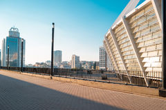 City at daytime. Buildings and blue sky. Stadium and business center Stock Images