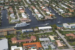 City of Deerfield Beach. Buildings, homes and intracoastal in Deerfield Beach, Florida. Yacht passing by stock image
