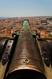 City defences. An ancient cannon overlooking the city of Lisbon, from the Sao Jorge Castle Stock Image