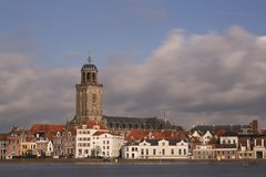 The city of Deventer, The Netherlands, and a blue sky and fluffy clouds. The city of Deventer, The Netherlands, and a blue sky with fluffy clouds, A long Royalty Free Stock Photos