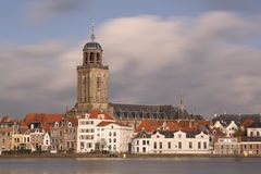 The city of Deventer, The Netherlands, and a blue sky and fluffy clouds. The city of Deventer, The Netherlands, and a blue sky with fluffy clouds, A long Stock Image