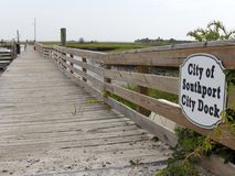 City Docks and Entry with View in Southport. Southport, NC, USA - July 28, 2014: City of Southport City Docks sign and entrance. Entry and sign to wooden Royalty Free Stock Images