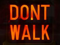 City: Dont Walk sign. Red Dont Walk pedestrian crossing sign detail Royalty Free Stock Photos