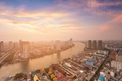 City downtown aerial view over river curved skyline with sunset backgroun. D, cityscape background Royalty Free Stock Image