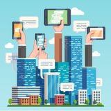 City downtown communications. Urban area social networking via modern smart devices, phones and tablets. Skyscrapers and hands holding technology. Flat style vector illustration
