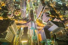 City downtown at night, Bird eyes view of Bangkok main traffic interchange, Long exposure. Bird eyes view of Bangkok main traffic intersection at night, Long Stock Image