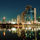 City downtown at night with reflection of skyline Stock Photography