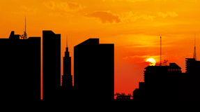 City downtown at sunset, skyline silhouette Stock Images