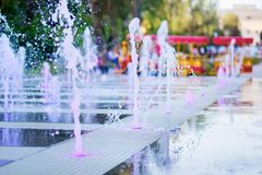 The city dry fountain with color illumination.  stock photo
