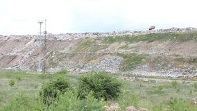City dump panorama. Huge garbage dumps outside the city stock video