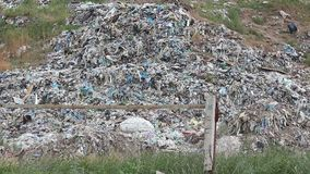City dump panorama. Huge garbage dumps outside the city stock footage