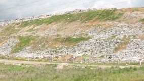 City dump panorama. Huge garbage dumps outside the city stock video footage