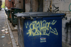 City dumpster. A city dumpster on a dirty alleyway royalty free stock images