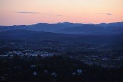 City in dusk Stock Photos