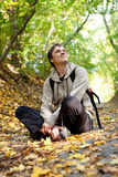 City dweller  in the autumn forest Royalty Free Stock Image