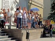 City dwellers look the street parade. Of Street Theatres on the Platonov Arts Festival Stock Photos