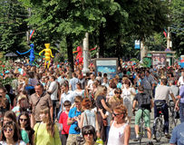 City dwellers look the street parade. Of Street Theatres on the Platonov Arts Festival on the city street Royalty Free Stock Photography