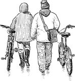 The city dwellers stroll with the bicycles Royalty Free Stock Photo