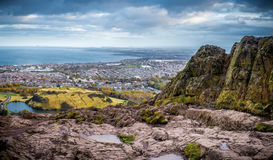 City of Edinburgh from Arthur`s Seat. Panoramic view of the city of Edinburgh, Scotland as seen from the top of an extinct volcano, Arthur`s seat, overlooking Royalty Free Stock Photo