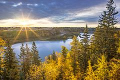 North Saskatchewan River valley at early morning. Alberta rural landscape with harvested field and north Saskatchewan river bank and island in the light of stock photography