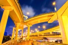 City elevated road closeup at night. City viaduct closeup, under the interchange overpass at night, shanghai, China Stock Photos