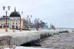 City embankment covered with ice after winter storm on the lake royalty free stock photo