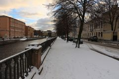 City embankment on a winter day royalty free stock images