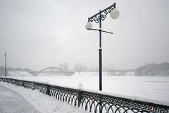 City embankment during a snowfall Royalty Free Stock Images