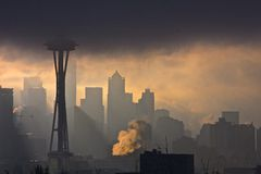 City Emerging From Fog. Sunlight and fog interplay on cityscape Royalty Free Stock Image