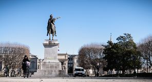 City employee who cleans the statue of Louis XIV in Montpellier, France royalty free stock images