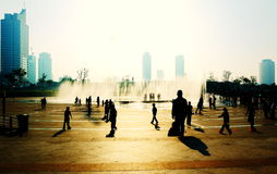 In city eruptive fountain square people. Sunday photographs to the Chinese Yantai seashore eruptive fountain square Royalty Free Stock Image