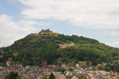City of Espalion. Overview of Espalion with the castle Calmont d'Olt in the background royalty free stock photo