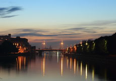 City in the evening. Night falls by the river in the city Royalty Free Stock Photography
