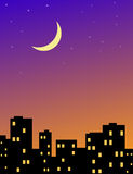 City evening. A moon in the evening sky above city Stock Photos
