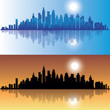 City at evening. City skylines at evening in two versions. Vector illustration Stock Photos