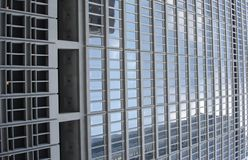 City Eyes. Highrise Building Windows facing Sky and Street Stock Image