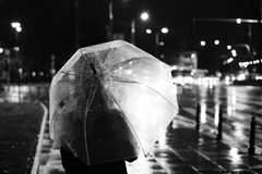 City fall. Woman with an umbrella in the urban night Royalty Free Stock Photo