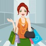 City Fashion Woman. Beautiful chic fashion woman walking through city avenue with shopping bags and handbag Royalty Free Stock Photos