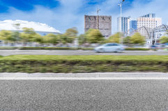 City fast road. Driving fast on the road in the city car Royalty Free Stock Images