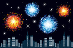City fireworks. Bright and colorful fireworks high above the city Royalty Free Stock Images