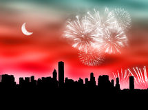 City fireworks. City skyline with fireworks in the cloudy sky Stock Photo