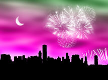City fireworks. City skyline with fireworks in the cloudy sky Royalty Free Stock Image