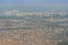 City from Flight Altitude. View on city from flight altitude, cityscape Stock Photo