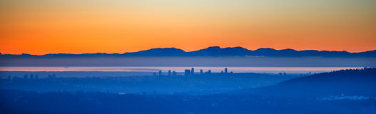 City in the fog at sunset Stock Photo