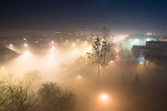 City on a foggy night Stock Images
