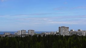 City in forest on lake shore pan stock footage