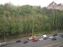 City and forest and road with traffic Royalty Free Stock Image