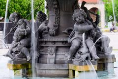 City fountain with figures of children and animals royalty free stock images