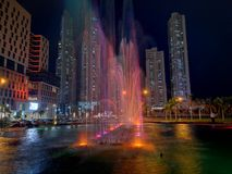 City fountain with lights. City fountain lights night water stock photography