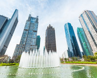 City fountain with modern buildings Stock Image